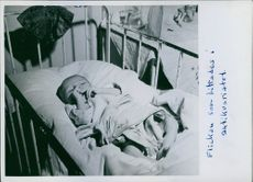 A photo of a baby refugee from Poland sleeping in a bed fled to  Norway caused by a World War II
