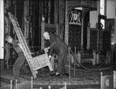 Princess Irene of the Netherlands' chair being removed from the Ridderzaal.