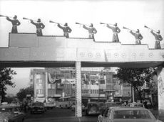 A gate decorated with men blowing horn trumpets.  - Oct 1967