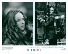 "A photos of Dr. Katherine Railly (Madeleine Stowe) in a film ""12 Monkey""."