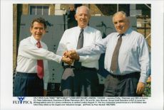 Chairman and CEO of Amoco, Laurance Fuller (middle), together with Peter Sutherland and John Browne.