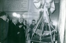 A photo of Royal King Frederick IX of Denmark looking in a turtle's back being displayed in the museum while press people taking photos. 1960