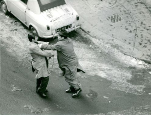 Mehdi Ben Barka fighting with a man.