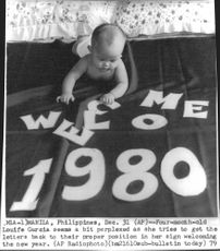 Baby Louife Garcia looking at the letters welcoming the new year