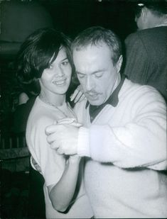 A photo of Jacques Esterel dancing with woman.