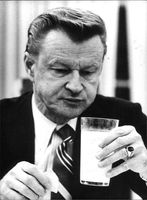 Zbigniew Kazimierz with a glass in his hand.