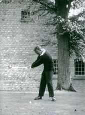 Famous American golfer Arnold Palmer is practicing.