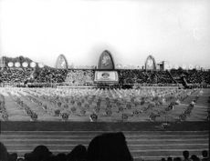 An event involving the royal family with the public gathered around the stadium.