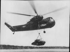 """Lightweight tension car """"Scorpion"""" M 56 lifted by a military helicopter."""