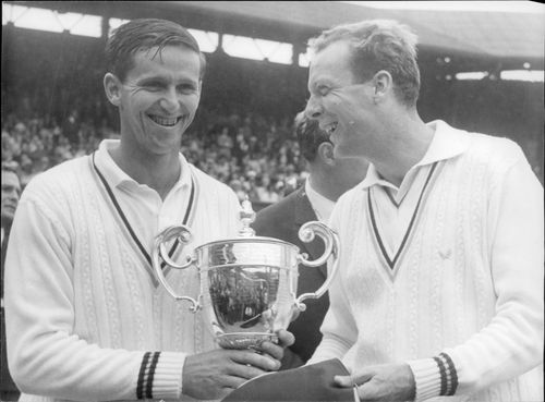 Roy Emerson is congratulated by opponent Fred Strolle to victory in Wimbledon. The title was Emerson's second in his career.