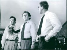 John Cusack, Colm Meaney and John Roselius in the film Con Air, 1997.