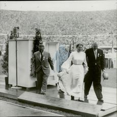 """""""Fredsduvan"""" Barbara Rotraut-Pleyer is removed from the speaker chair during the opening ceremony"""