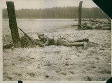 German infantrymen laying on the ground as they engage in gun fight on Soissons, 1915.