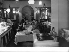 Roberto Rossellini dining with his friends.