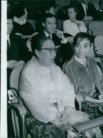 Members of U Thant's family watch as he is elected as acting Secretary-General of the United Nations. Front row are: His wife, Mme. Thant and daughter Aye Aye. Seated behind them are son-in-law Tyn Myint and son Tin Maung Thant. 1961.