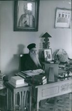 Athenagoras I photographed sitting at his desk in Jerusalem. 1964.