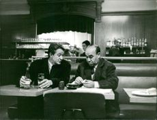 Mehdi Ben Barka brother enjoying drinks with a man.