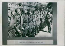 Russian Forces 1942 Popular guards unit of Leningrad standing, and officer speaking.