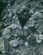 A sign board of mines on the cliff.