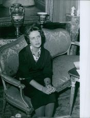 Duchess Marie Thérèse sitting on a couch.