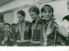 Women medalists posing for the camera.