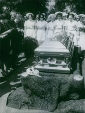 Photo of people gathered in a burial (July 25, 1966).