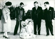 Emperor Hirohito with his family: Empress Nagako, Crown Prince Akihito, Emperor Hirohito, Prince Yoshi, Crown Princess Michiki with Little Prince Hiro in Toy Car