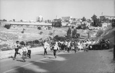 Crowd running on the street in Israel.