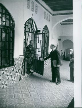 Man greeting army officer.