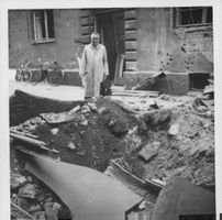 A man posing on dilapidated area in Finland.  - Aug 1941
