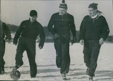 Men playing football together. 1944