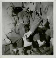 Soldier inspecting the wounded soldiers.