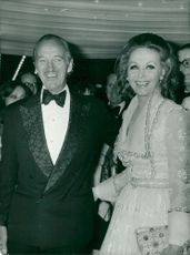 """David Niven with wife Heard at the premiere of """"Paper Tiger"""" at the Odeon Theater in Leicester Square"""