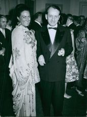 Italian soprano Renata Tebaldi seen with French Novelist André Malraux with smiling face at Paris Opera