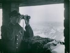 Russian soldiers in Poland looking through a binocular. 1948