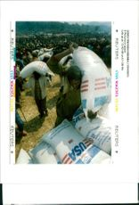 Rwanda war:rwandan refugees puts a sack of maize.