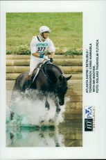 Chris Hunnabla and his Bootsie in the water barrier in the terrain moment in the field competition.