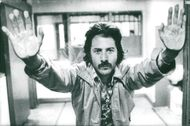 "Dustin Hoffman in the movie ""Staright time""."