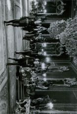Military men walking in the hall.