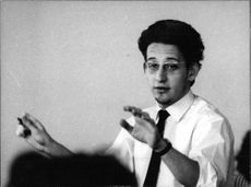 Boris Brott, guiding musicians, with his hands in motion.