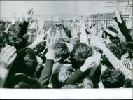 Gaston Defferre surrounded by the people, 1969.