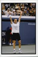Andre Agassi receives the audience's cheers after the win during the US Open.