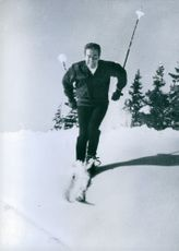Jean-Jacques Servan-Schreiber skiing in the snow during winter.
