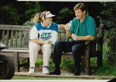 Caddien Fanny Sunesson and golf player Nick Faldo during European Open 1992