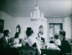 Victor Borge having a meal with other people.