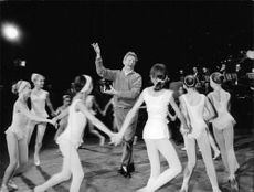 Danny Kaye group dancing on stage.