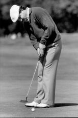 Portrait of golfer Gordon Brand in action