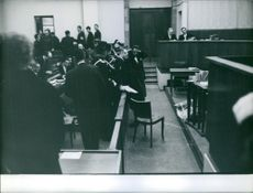 People gathered in courtroom.