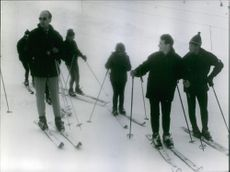 Valéry Giscard d'Estaing is ice skating with friends.  1965