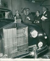 President tubman of liberia inspecting a rolls royce which be bought in only five minutes.